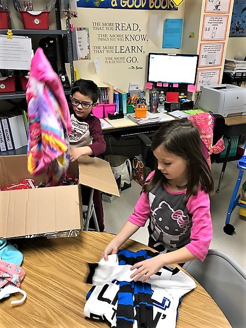 Kelly Elementary Pays It Forward with Donations to Needy Children